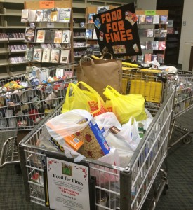 Shopping Carts in the Visalia Branch Library quickly filled up with items donated to the 'Food for Fines' program