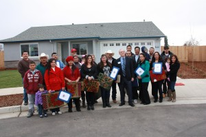 USDA California Rural Development Single Family Housing Program Director Ron  Tackett joins 11 families in front of one of the homes they jointly built in Reedley.