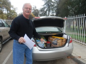 Dr. Larry Weber, an advocate for the Mooney Grove cats, drives around with cat food and supplies in his trunk.