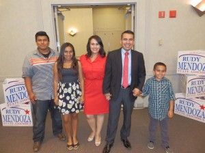 Rudy Mendoza and family arrive to a victory celebration at the Visalia Convention Center.