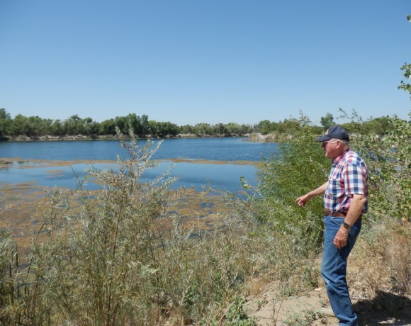 Local farmers — such as George Clausen, pictured — want to know, why, if their wells are going dry because of the drought, the CEMEX ponds are brimming full of water.