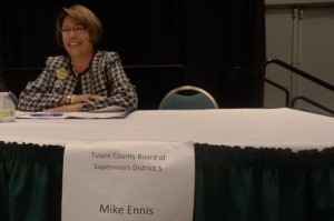 Virginia Gurrola, Tulare County Board of Supervisors candidate, sits next to an empty chair reserved for heropponent, Mike Ennis.
