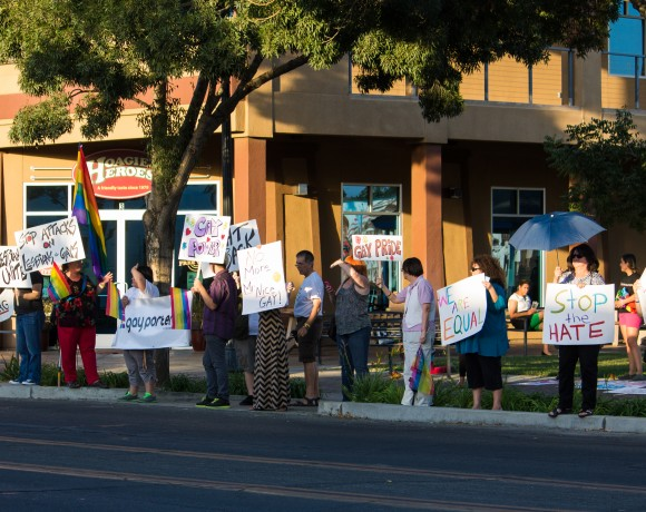 Protesters assemble across from the Porterville City Council chambers.