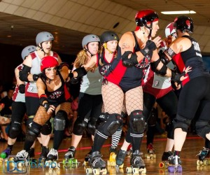 The V Town Dames battle to beat Sacramento's Sacred City Derby Girls. The V Town Dames (in red and black), include Jessica Loya, Amber Clark, Chrissy Buma and Melissa Hawkins. Photo by David Costa.