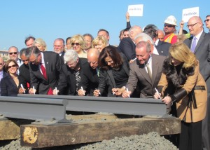 Instead of the traditional shovels in the ground, Governor Jerry Brown, Fresno Mayor Ashley Swearengin, Gina McCarthy, head of the Environmental Protection Agency, and about 40 other dignitaries signed a ceremonial piece of steel rail that will be on display at the Sacramento Railroad Museum.