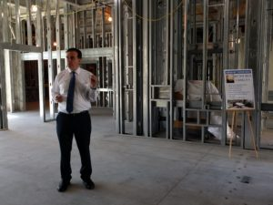 Healthcare Conglomerate Associates CEO Benny Benzeevi speaks to the  assembled press about the Tulare Regional Medical Center Tower One construction.