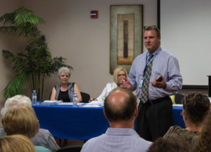 Shawn Burgess, the CIO for Healthcare Conglomerate Associates, speaks at the August 24 TLHCD Board meeting.