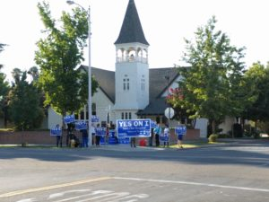 Measure I proponents held signs and chanted outside the No on I forum. Tony Maldonado/Valley Voice