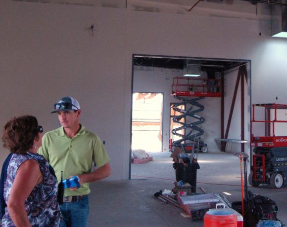Lisa Whitworth, principal of Farmersville High, and Roland Johnston, site manager for Forcum Mackey Construction, talk amidst the construction of Farmersville High's new Vocational Education-Career Technology Center. Nancy Vigran/Valley Voice