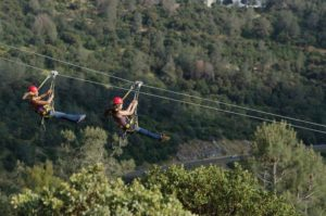 Let your hair flow in the wind while you zipline! Cave & Mine Adventures offers twin zip lines. Courtesy/Jason Smith/Cave & Mine Adventures